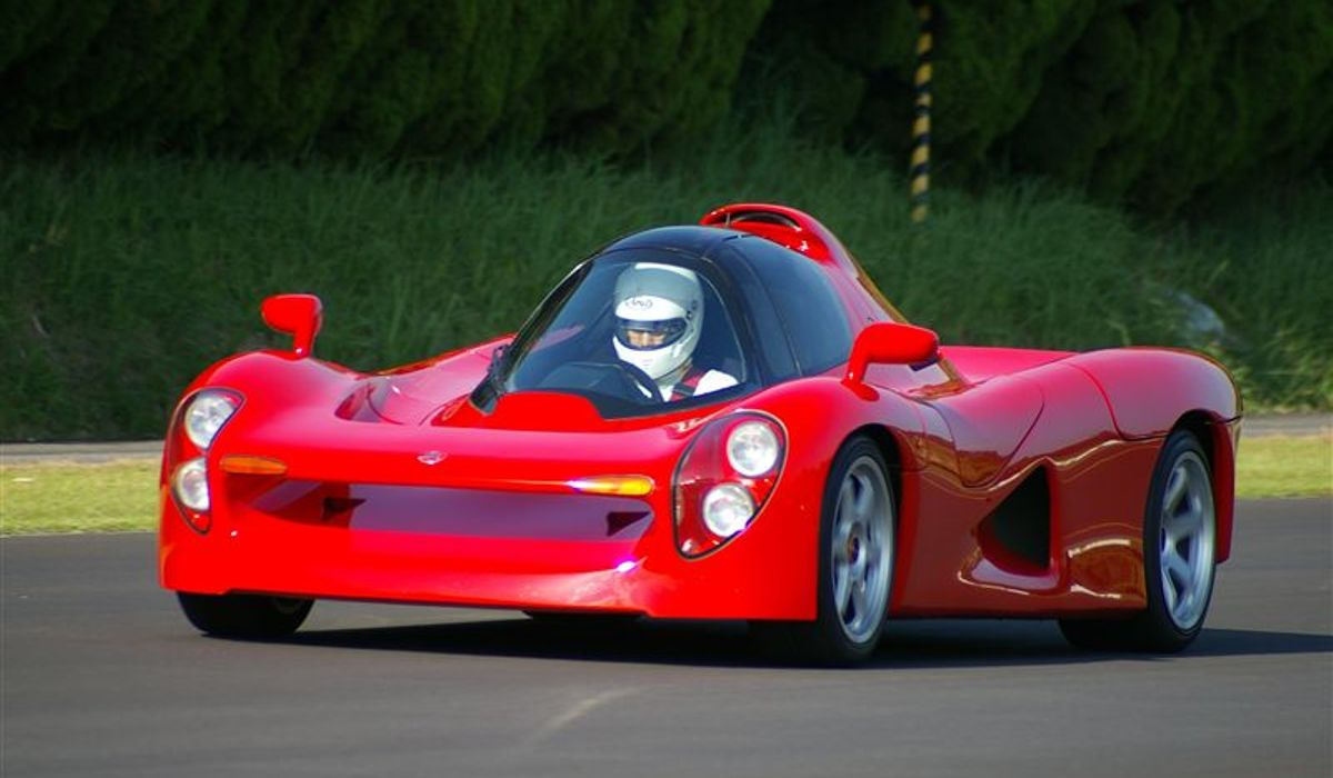 Red Yamaha OX99-11 being driven down road
