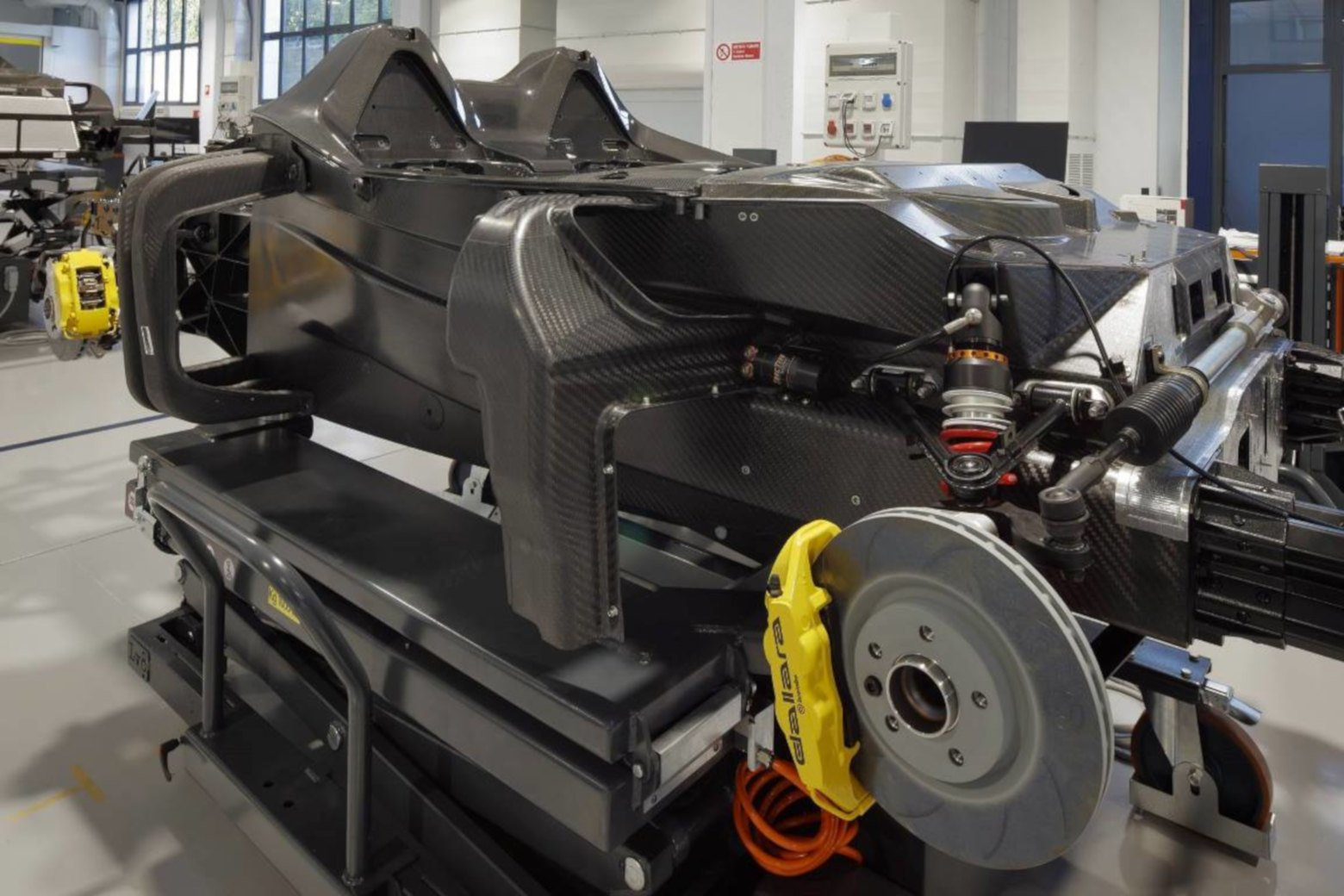 Dallara Stradale carbon fibre chassis and front suspension.