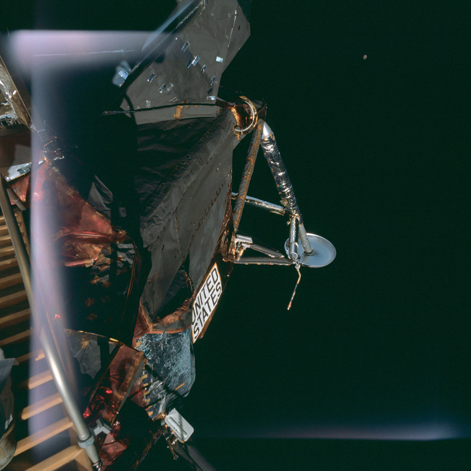 The Apollo Lunar Module (callsign: Spider) with its eventual destination behind it.
