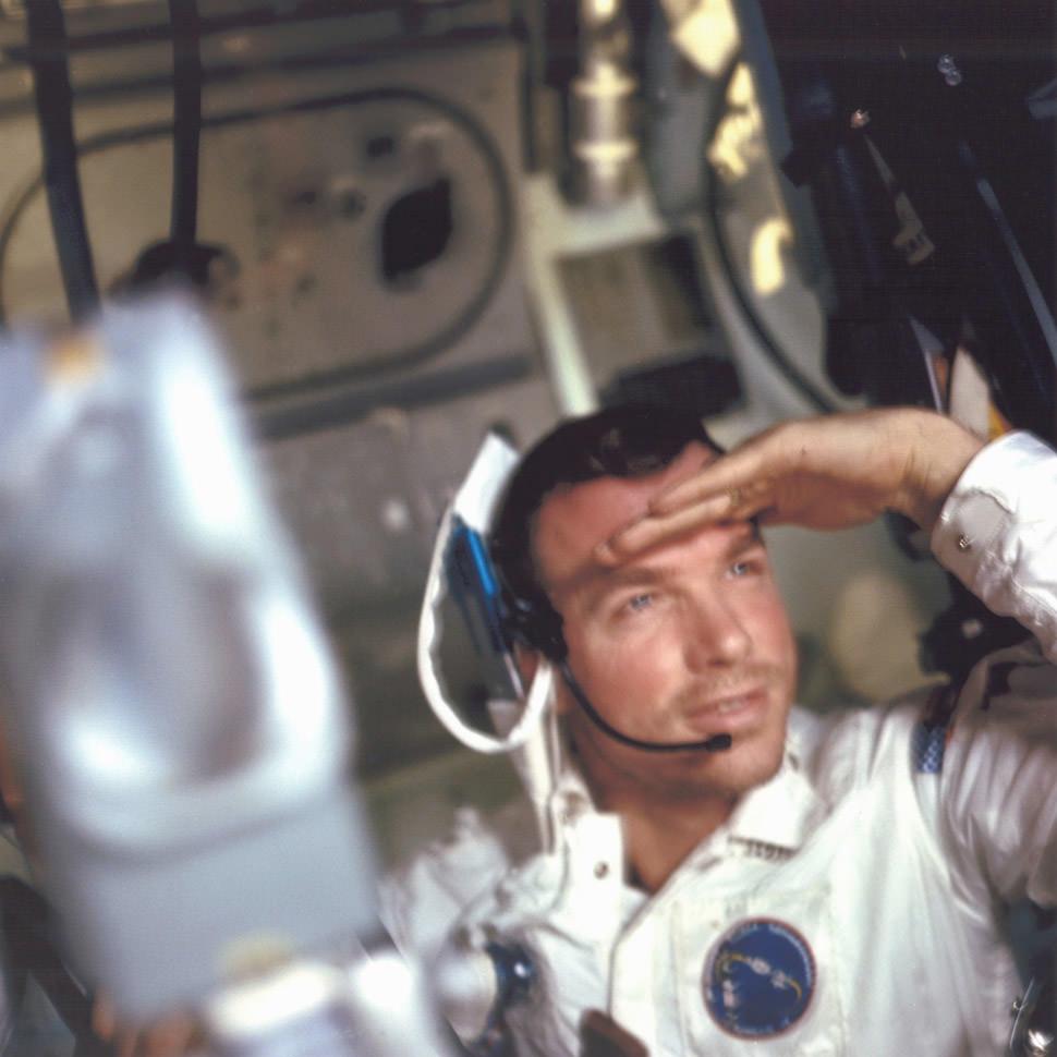 Command Module pilot David Scott getting a look outside.