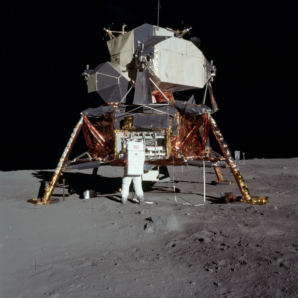 Aldrin unpacking experiments during their 2.5-hour moonwalk.