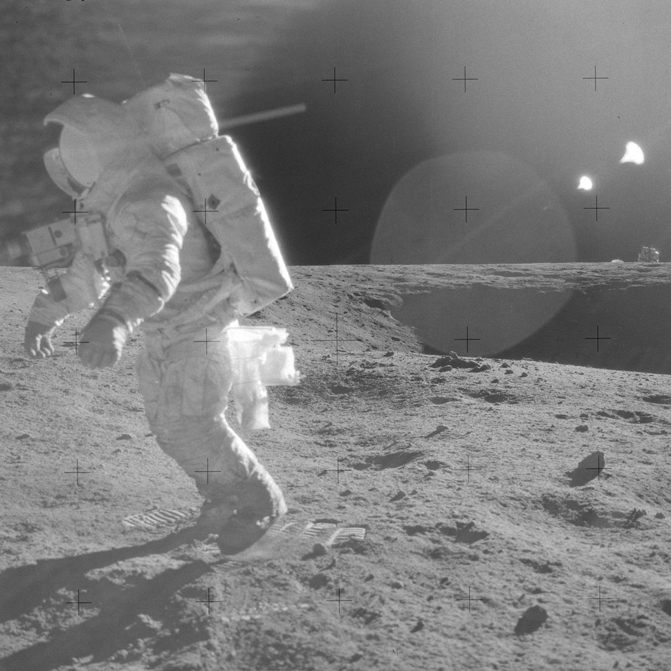 Alan Bean traversing the Lunar Surface. LM in background.