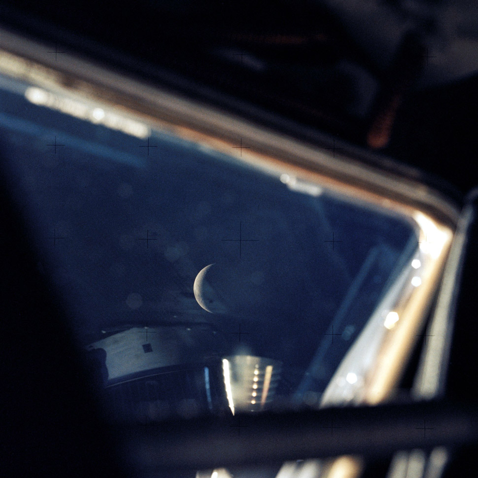 The crew's view of the moon from the Lunar Module. Worth noting is that they switched to the two Lunar Module Hasselblads that were supposed to be used and discarded on the moon.