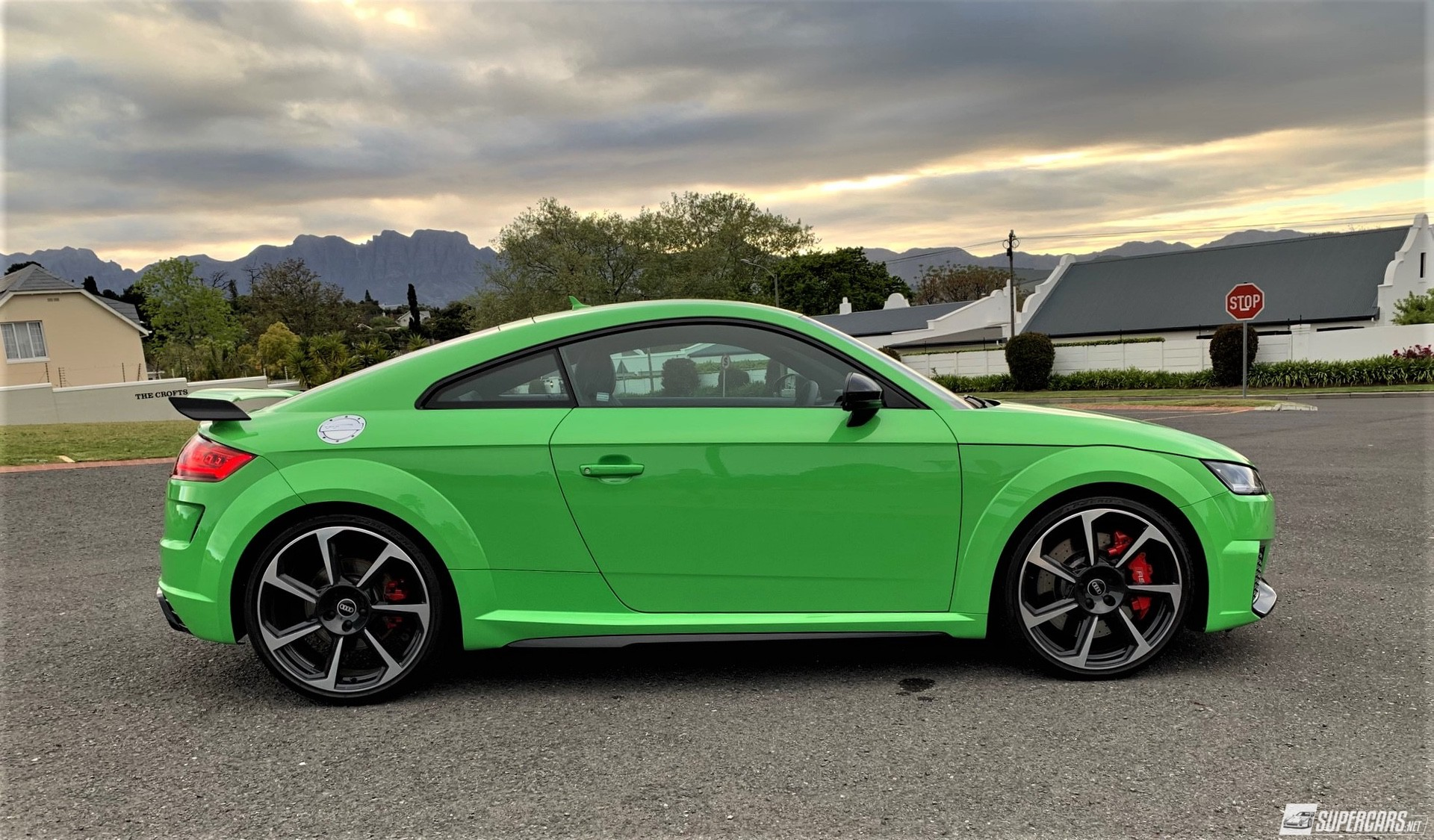 Side view of green 2022 Audi TT RS