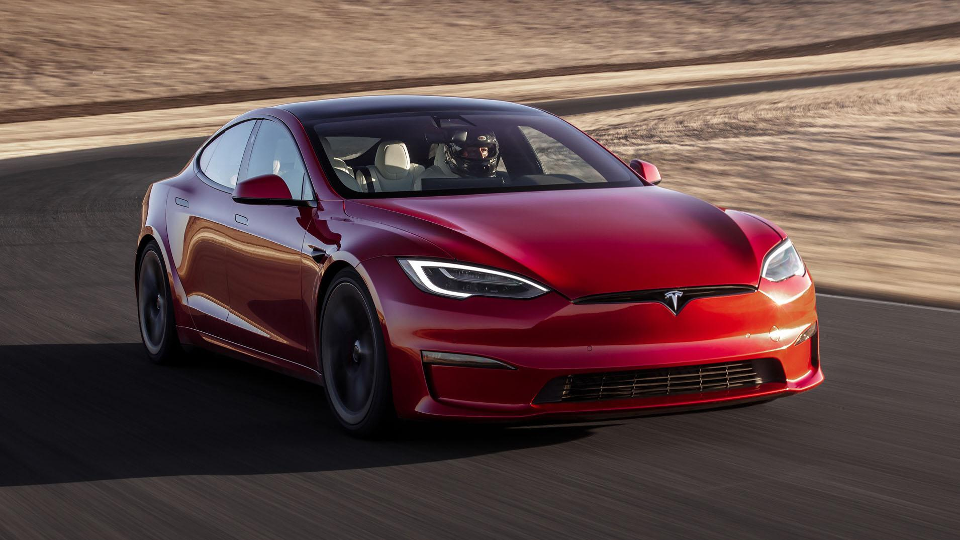 A side view of a Tesla Model S Plaid being tried out on the track