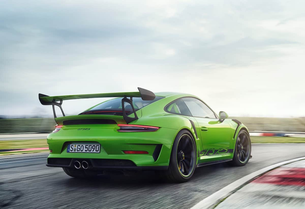 Green 2019 Porsche GT3 RS being driven on track