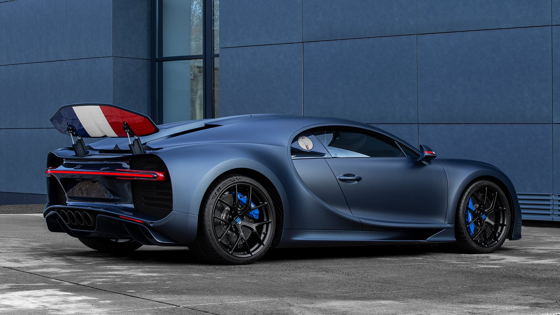 Blue Bugatti Chiron Sport 110 Ans Edition outside garage
